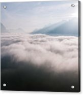 Aerial View Of Low Clouds And Mountain Peak At Sunrise Acrylic Print