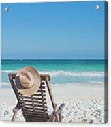 Beach Chair With A Hat On An Empty Beach Acrylic Print