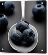 blueberries and a silver spoon on distressed wood No. 2 Acrylic Print