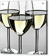 Close-up Of Three White Wine Glasses Acrylic Print