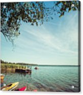 Colorful Kayaks Moored On Lakeshore Acrylic Print