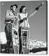 Couple Holding Snowshoes, Woman Pointing Acrylic Print