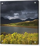 Dark Storm Clouds Hang Over The Acrylic Print