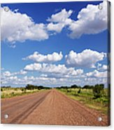 Dirt Road And Puffy Clouds Acrylic Print