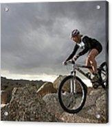 Female Rider Mountain Biking Between Acrylic Print