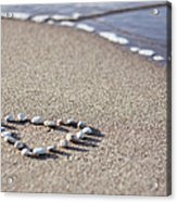 Heart Made Of Pebbles On Sand Acrylic Print