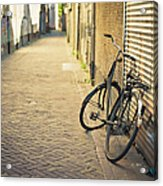 Old Abandoned Bicycle Leaning On The Acrylic Print