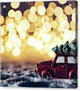 Red Car With Christmas Tree Driving Through Snow Acrylic Print