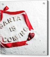 Santa Is Coming Text And Red Ribbon Acrylic Print