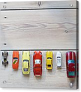 Toy Cars Lined Up In A Row On Floor Acrylic Print