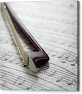 Violin Bow On Music Sheet Acrylic Print