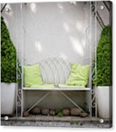 White Bench Made Of Iron With Two Green Bushes On The Side Acrylic Print
