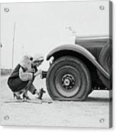 Woman Changing Flat Tire On Car Acrylic Print