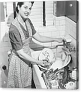 Woman Washing Dishes In Kitchen Sink Acrylic Print
