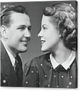 Young Couple Looking In Eyes In Studio Acrylic Print