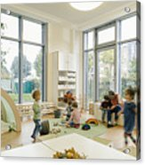 Pre-school teacher and children in playing in learning room in kindergarten Acrylic Print