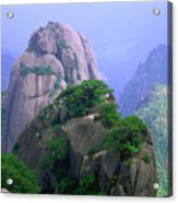 A Rocky Outcropping Overlooks A Mist-covered China Mountain Range Acrylic Print