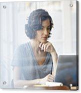 Businesswoman using laptop in office Acrylic Print