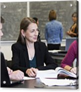 Caucasian students and teacher talking in classroom Acrylic Print