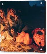 Friends enjoy evening on the beach by the log fire Acrylic Print