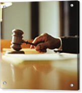 Male judge striking gavel in courtroom, close-up Acrylic Print