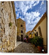 Narrow alley and old houses with plants outside in Castelmola Taormina Sicily Italy Acrylic Print