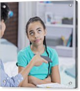 Preteen girl rolls eyes as mom takes away her phone Acrylic Print