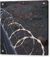 Razor wire on a fence on the coast Acrylic Print