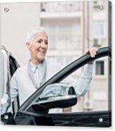 Senior Woman Smiling While Entering A Car Acrylic Print