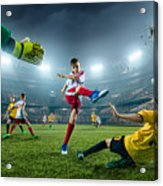 Soccer kids players scoring a goal. Goalkeeper tries to hit the ball Acrylic Print