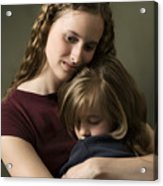 Studio Portrait Of A Caucasian Female Child With A Purple Shirt Hugging Her Little Sister Tightly Acrylic Print