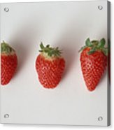 Three strawberries in a row, close-up, white background Acrylic Print