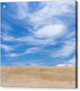 View Of Sand Against Blue Sky And Clouds Acrylic Print