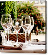 Wineglasses and table setting Acrylic Print