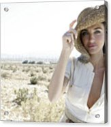Woman outdoors holding large hat Acrylic Print