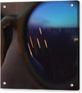 Woman wearing fashionable eyewear. City lights reflecting in glasses Acrylic Print