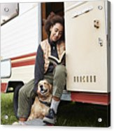 Woman with dog reading book in motor van Acrylic Print