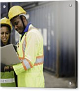 Young African american men and woman worker Check and control loading freight Containers by use computer laptop at commercial shipping dock felling happy. Cargo freight ship import export concept Acrylic Print