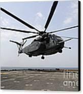 An Mh-53e Sea Dragon Prepares To Land Canvas Print