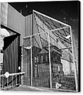 anti rpg cage surrounding observation sanger at North Queen Street PSNI police station Belfast North Canvas Print by Joe Fox