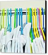 Clothes Hangers Canvas Print by Tom Gowanlock