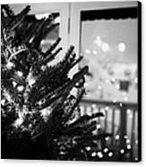 decorated christmas tree looking out of window to snow covered scene in small rural village of Forge Canvas Print