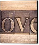 Love In Printing Blocks Canvas Print by Jane Rix
