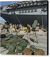 Marines Move Gear During An Embarkation Canvas Print by Stocktrek Images