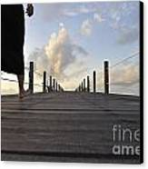 Woman Walking On Wooden Jetty At Sunrise Canvas Print by Sami Sarkis