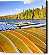 Canoes On Autumn Lake Canvas Print by Elena Elisseeva