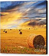 Golden Sunset Over Farm Field With Hay Bales Canvas Print