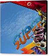 Colorful Fairground Ride Canvas Print by Ken Biggs