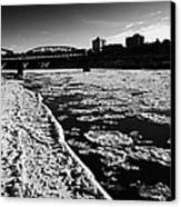 large chunks of floating ice on the south saskatchewan river in winter flowing through downtown Sask Canvas Print