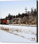 A Freight Train On A Snowy Day  Canvas Print by Tom Druin